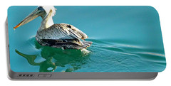 Portable Battery Charger featuring the photograph Pelican Swimming by Clare Bevan