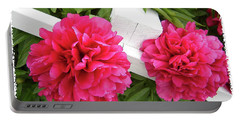 Peonies Resting On White Fence Portable Battery Charger by Barbara Griffin