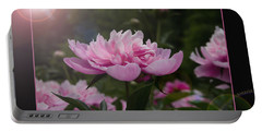 Portable Battery Charger featuring the photograph Peony Garden Sun Flare by Patti Deters