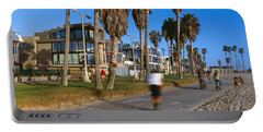 People Riding Bicycles Near A Beach Portable Battery Charger by Panoramic Images