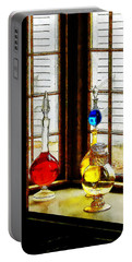 Portable Battery Charger featuring the photograph Pharmacist - Colorful Bottles In Drug Store Window by Susan Savad
