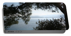 Portable Battery Charger featuring the photograph Pine Trees Overhanging The Aegean Sea by Tracey Harrington-Simpson