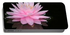 Pink Water Lily In A Dark Pond Portable Battery Charger