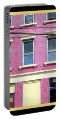 Portable Battery Charger featuring the photograph Pink Yellow Blue Building by Kathy Barney