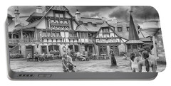 Portable Battery Charger featuring the photograph Pinocchio's Village Haus by Howard Salmon