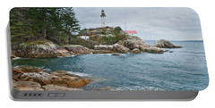 Portable Battery Charger featuring the photograph Point Atkinson Lighthouse And Rocky Shore by Jeff Goulden