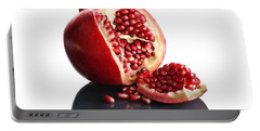 Pomegranate Opened Up On Reflective Surface Portable Battery Charger