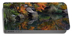 Pond In Autumn Portable Battery Charger