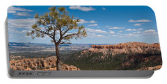 Portable Battery Charger featuring the photograph Ponderosa Pine Tree Clinging To Life On Canyon Rim by Jeff Goulden