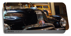 Portable Battery Charger featuring the photograph Pontiac Streamliner 1947 by John Schneider