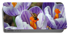 Portable Battery Charger featuring the photograph Popping Spring Crocus by Debbie Oppermann