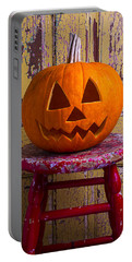 Pumpkin On Red Stool Portable Battery Charger