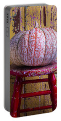 Pumpkin Sitting On Red Stool Portable Battery Charger