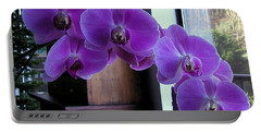 Portable Battery Charger featuring the photograph Purple Orchid by AJ  Schibig