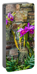 Purple Orchids With Cultured Stone Background Portable Battery Charger
