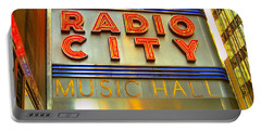 Portable Battery Charger featuring the photograph Radio City Music Hall by Judy Palkimas