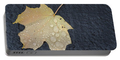 Rain Drops On A Yellow Maple Leaf Portable Battery Charger