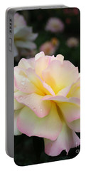 Portable Battery Charger featuring the photograph Raindrops On Rose Petals by Barbara McMahon
