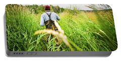 Rear View Of Fly Fisherman Walks Portable Battery Charger