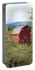 Portable Battery Charger featuring the photograph Red Barn And Apple Blossoms by Patricia Babbitt