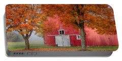 Portable Battery Charger featuring the photograph Red Barn With White Barn Door by Jeff Folger