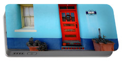 Red Door On Blue Wall Portable Battery Charger by Joe Kozlowski