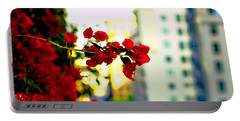 Portable Battery Charger featuring the photograph Red Flowers Downtown by Matt Harang