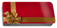 Red Gift Background With Gold Ribbon Portable Battery Charger