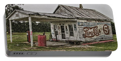 Red Lyon Country Store Portable Battery Charger by Victor Montgomery