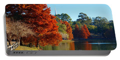 Red Pine On Lake Ella Portable Battery Charger by Gail Kent