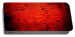 Red Rain Portable Battery Charger by Dave Bowman