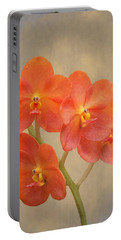 Red Scarlet Orchid On Grunge Portable Battery Charger