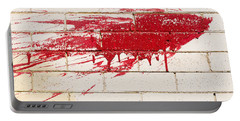 Red Splash On Brick Wall Portable Battery Charger