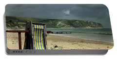 Portable Battery Charger featuring the photograph Redundant Deck Chairs by Linsey Williams