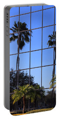 Portable Battery Charger featuring the photograph Reflected Window by Rosalie Scanlon