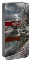 reflection of Slaughterhouse covered bridge Portable Battery Charger by Jeff Folger