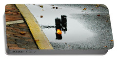 Portable Battery Charger featuring the photograph Reflection Of Traffic Light In Street Puddle by Gary Slawsky