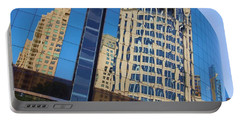 Portable Battery Charger featuring the photograph Reflections In The Rolex Bldg. by Robert ONeil
