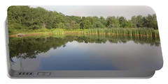 Reflections Of A Still Pond Portable Battery Charger by Michael Porchik