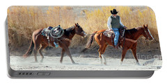 Portable Battery Charger featuring the photograph Rio Grande Cowboy by Barbara Chichester