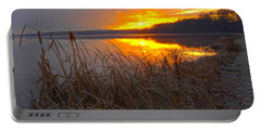 Portable Battery Charger featuring the photograph Rising Sunlights Up Shore Line Of Cattails by Randall Branham