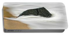 Surf Caresses A Lonely Stone Portable Battery Charger by Gary Slawsky