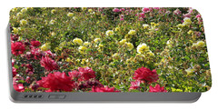 Portable Battery Charger featuring the photograph Roses Roses Roses by Laurel Powell