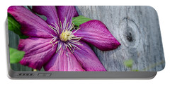 Portable Battery Charger featuring the photograph Rustic Clematis by Susan  McMenamin