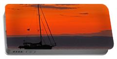 Sailboat At Sunset Portable Battery Charger by Marcia Socolik
