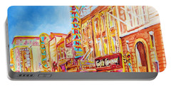 Portable Battery Charger featuring the painting Saint Catherine Street Montreal by Carole Spandau