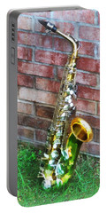 Saxophone Against Brick Portable Battery Charger