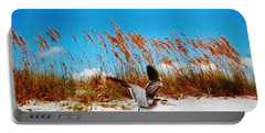Portable Battery Charger featuring the photograph Seagull In Flight Beach Landing by Belinda Lee
