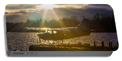 Seaplane Sunset Portable Battery Charger by Charlie Duncan