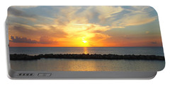 Portable Battery Charger featuring the photograph Seven Mile Sunset Over Grand Cayman by Amy McDaniel
